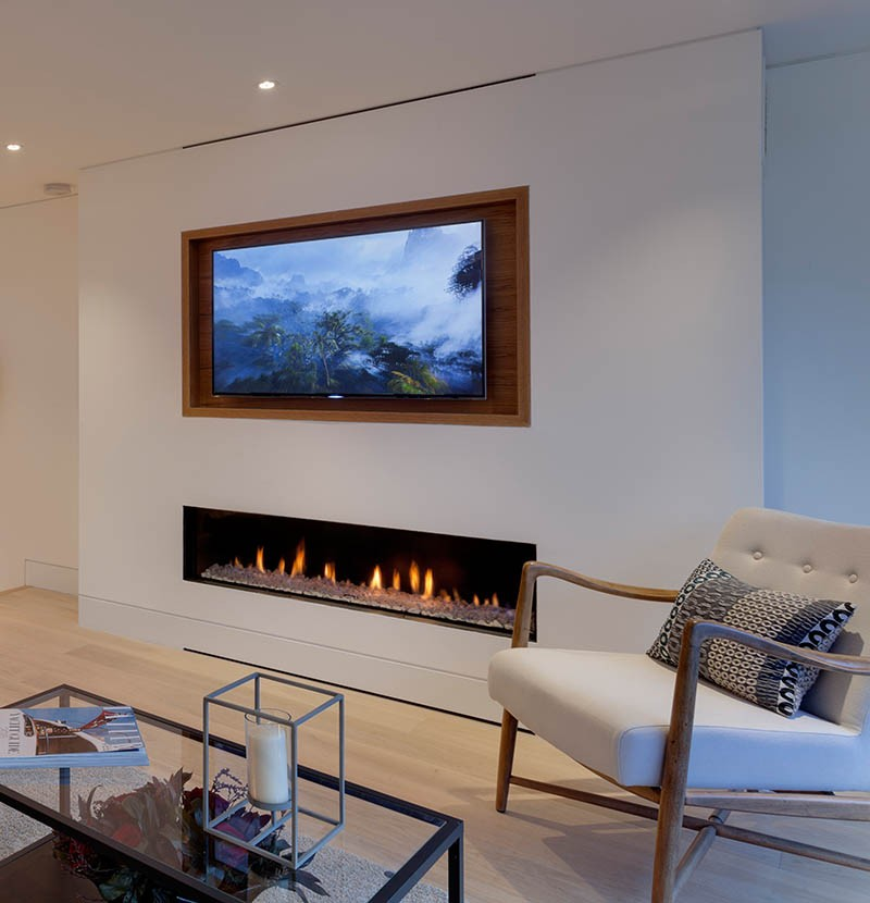 Design tip recess a tv above a fireplace contemporist for Tv over fireplace