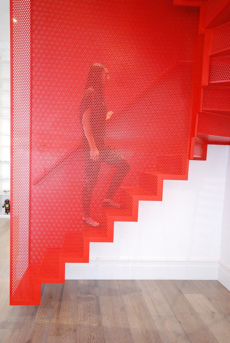 Hanging Red Stairs by Michaelis Boyd Associates