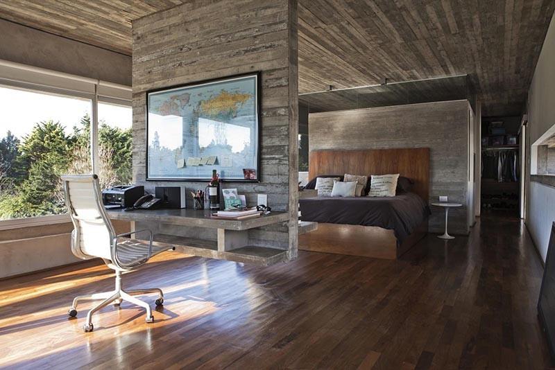 Hanging concrete room divider with a floating desk.