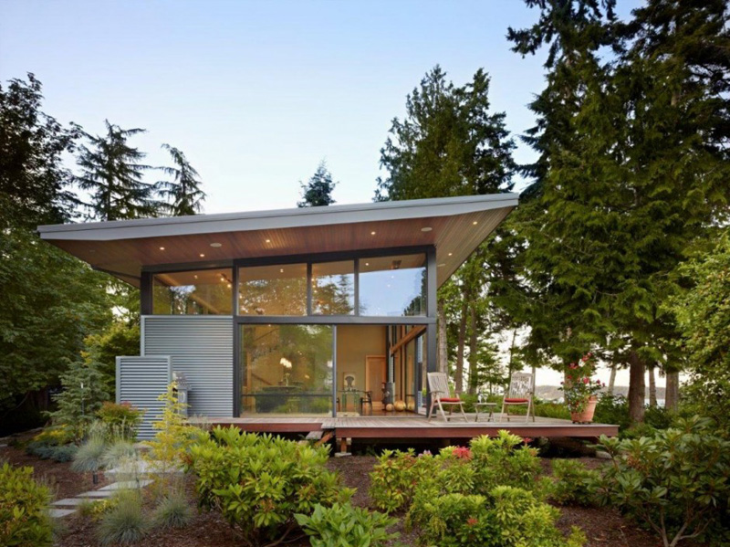 This pacific northwest house is located on a wooded for Pnw home builders