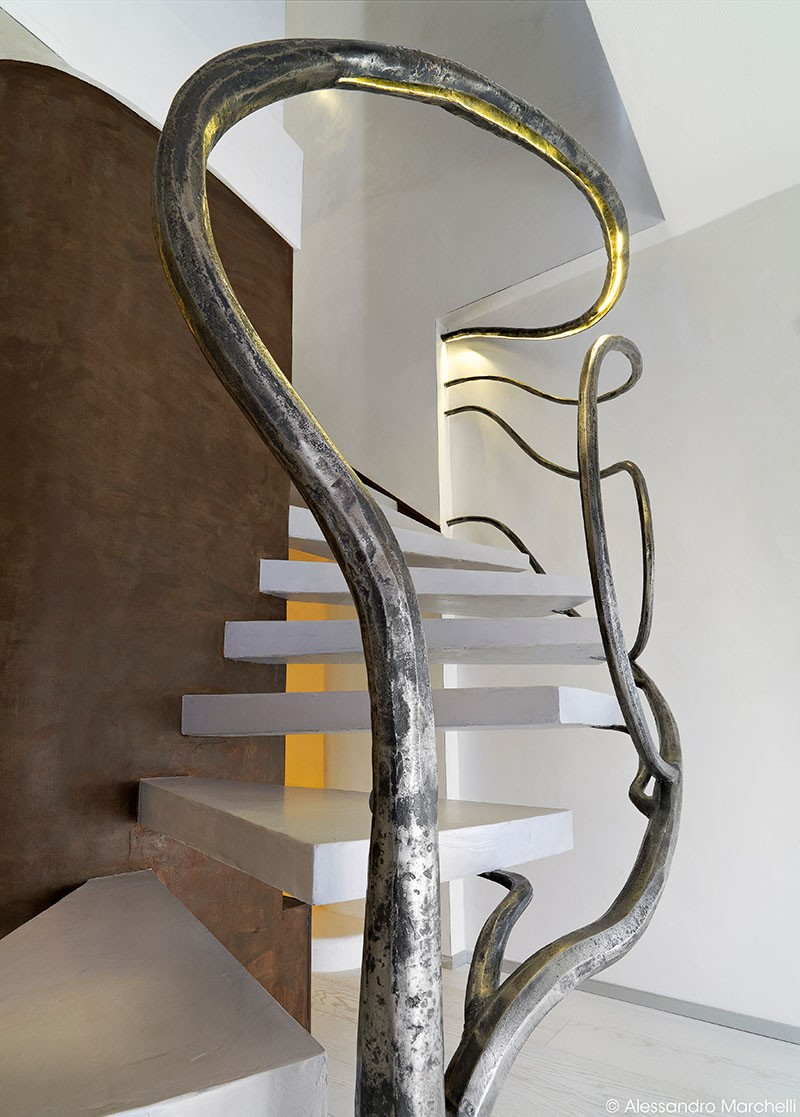 Tree-Like Sculpture Acts As A Railing For These Stairs