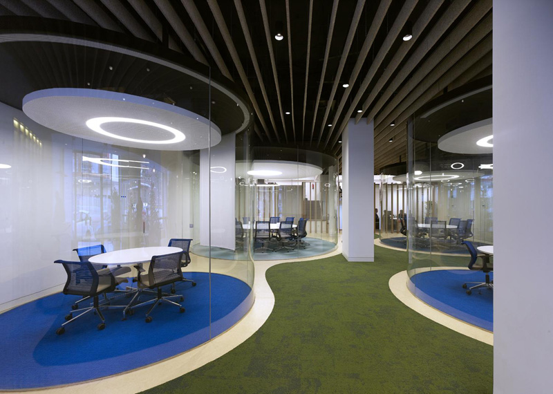 MVN Architects Design Transparent Glass Cylinder Meeting Rooms