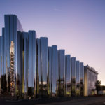 This New Museum Is Wrapped In A Wavy Facade Of Reflective Stainless Steel