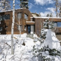 Rusty weathering steel covers this mountain house in utah Cost to build a house in utah
