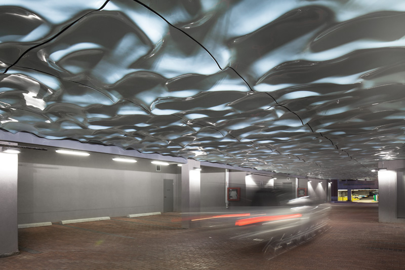 Paul Raff Studio Add Water-Like Sculpture To Ceiling Of Parking Area