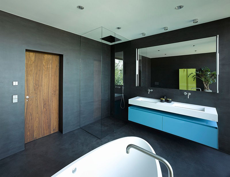 Black Walls design detail - a bathroom with black walls and a black floor
