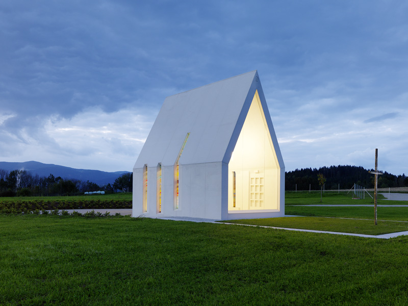 This Small White Chapel Stands Tall In The Austrian Countryside