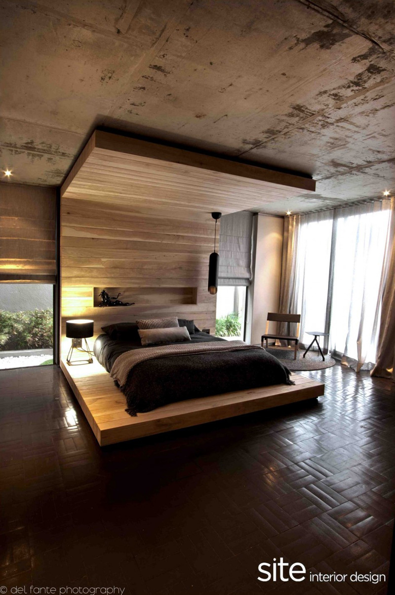 7 Bedrooms That Feature Floor-To-Ceiling Headboards