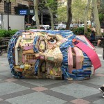 There's a big head made from reclaimed wood and found objects lying in a park in New York