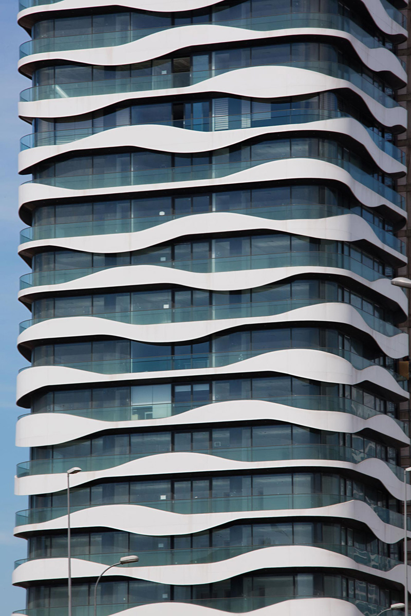 Wavy balconies surround a new office building in istanbul for Building balcony