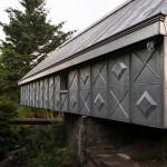 This Artist Studio Covered In Embossed Zinc Panels Hangs Over A Creek