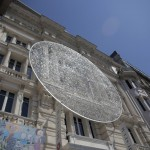 Artists Install Sculpture Using 14,000 Eyeglass Lenses On Exterior Of Museum
