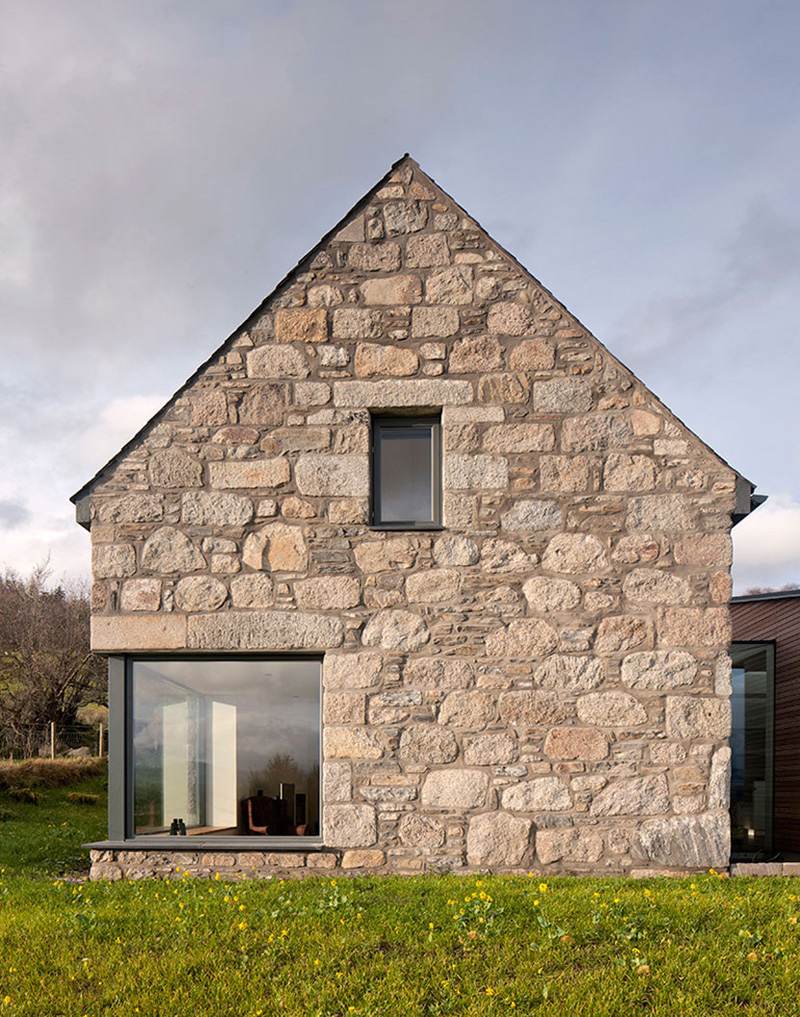 Derelict stone buildings restored and contemporized into a for Cobblestone house