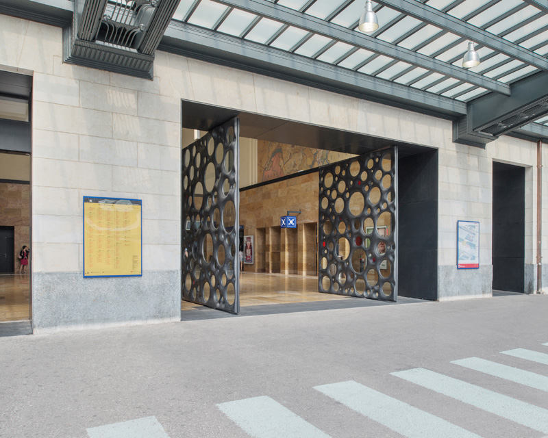 Sculptural Concrete Doors Welcome You To A Train Station In Geneva