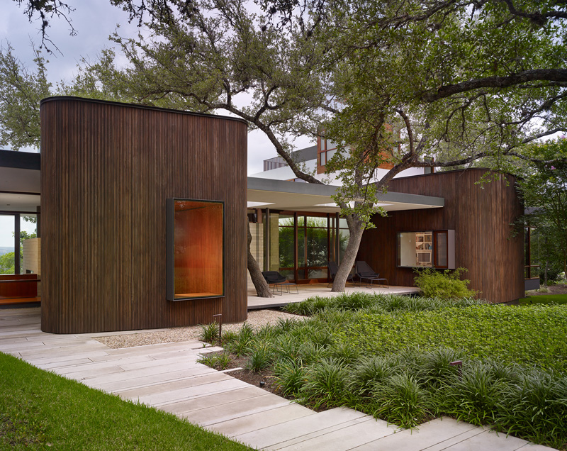 a home in the midst of mature oak trees for a family in
