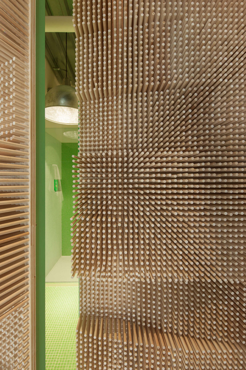 This Creative Wall Of Dowels Hide A Bathroom Within