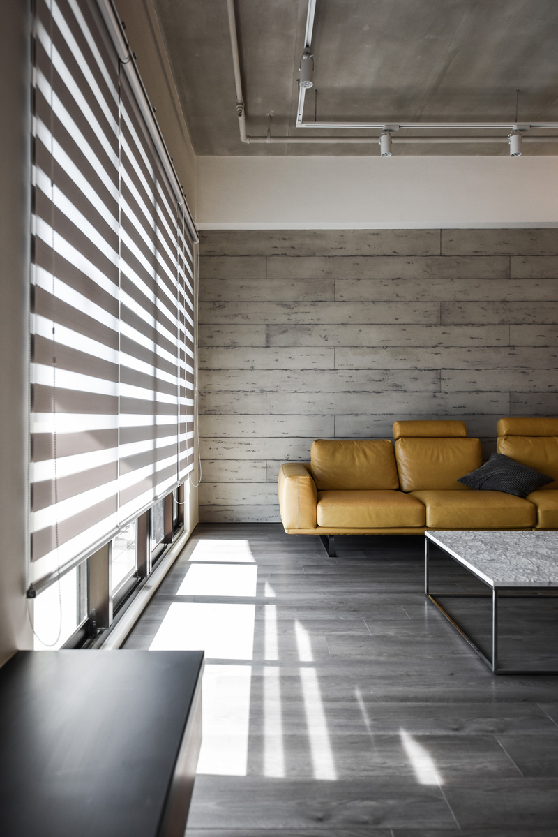 a palette of wood, metal, and concrete for this apartment interior
