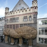An organically-shaped bamboo facade installed at a German art museum