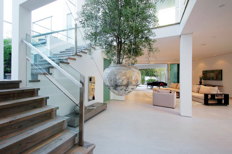 A large suspended planter catches your eye in this Los Angeles home