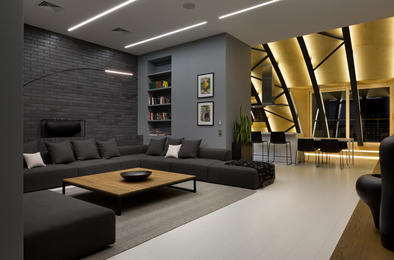 This modern apartment interior has a decorative ceiling element with hidden lighting. #ApartmentDesign #Ceiling #Lighting