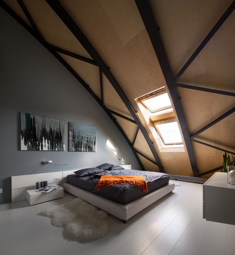 This modern apartment interior has a decorative ceiling element with hidden lighting. #ApartmentDesign #Ceiling #Lighting #Bedroom