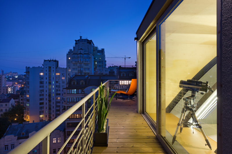 This modern apartment has a balcony that shows off the views of the city. #Balcony