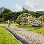A twisted trefoil knot sculpture has arrived in this urban park