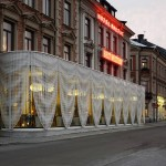 A hotel in Sweden gets a pavilion draped with perforated aluminium