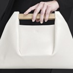 The architecture of bridges inspired the design of these handbags