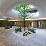 "Trees grow through two ""elliptical eyes"" of a suspended garden at this building"