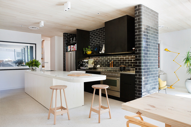 A Central Wall Of Glazed Bricks Forms The Kitchen In This - Kitchen architects