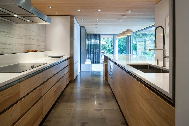 White countertops and wood cabinets in a contemporary kitchen
