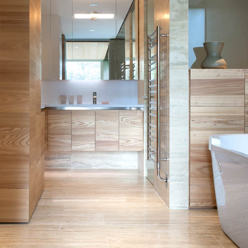 A contemporary bathroom with plenty of wood