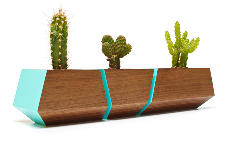 A modern Boxcar Succulent planter by Revolution Design House that includes bright blue accents. #Planters #SmallPlanters #Plants #Decor #HomeDecor #GiftIdea