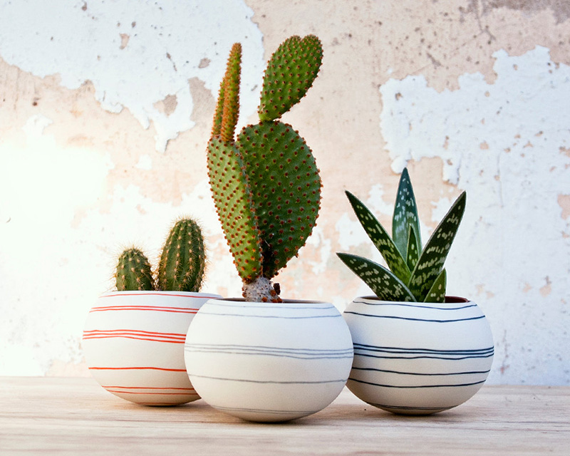 The thin colorful lines compliment the rounded shaped sphere of this small planter by wapa. #Planters #SmallPlanters #Plants #Decor #HomeDecor #GiftIdea
