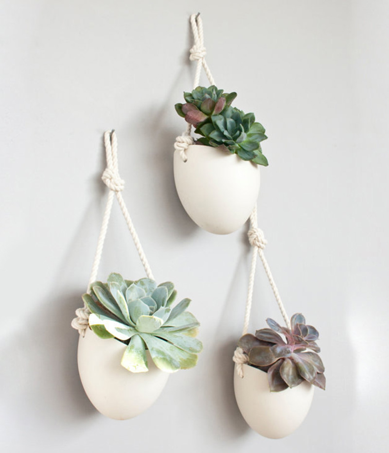 Porcelain and cotton rope hanging planters, like these designed by Light+Ladder, can be used to decorate a plain wall.  #Planters #SmallPlanters #Plants #Decor #HomeDecor #GiftIdea