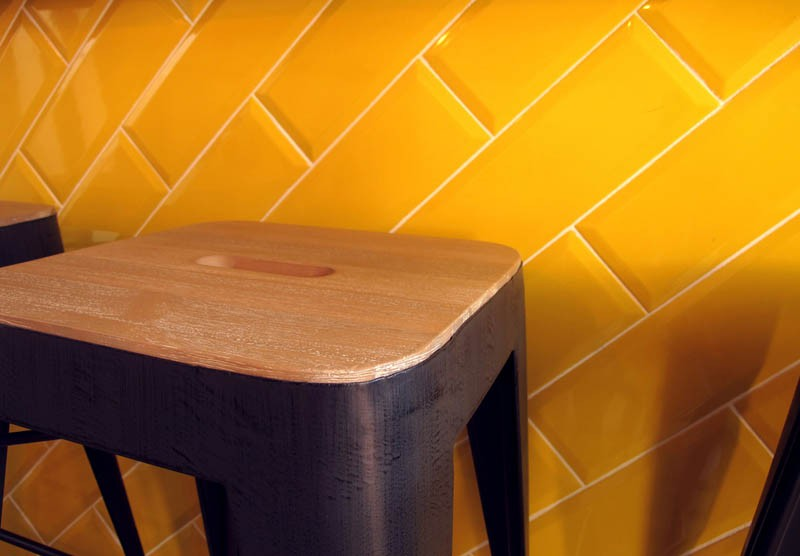 Diagonal beveled tiles in lemon yellow