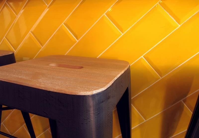 Diagonal beveled tiles in lemon yellow