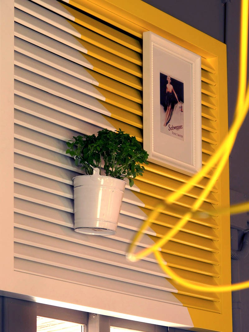 Decorative blinds painted white and yellow