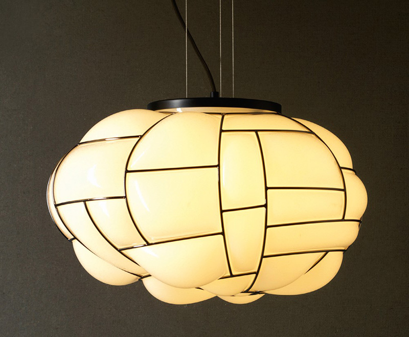 Watch how this bulging glass lamp is made
