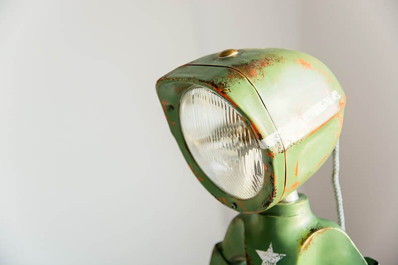 This lamp looks like a little robot man