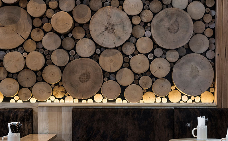 A Giant Log Wall Is A Focal Point In This Restaurant In Australia