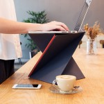 This portable standing desk folds down to the size of a magazine