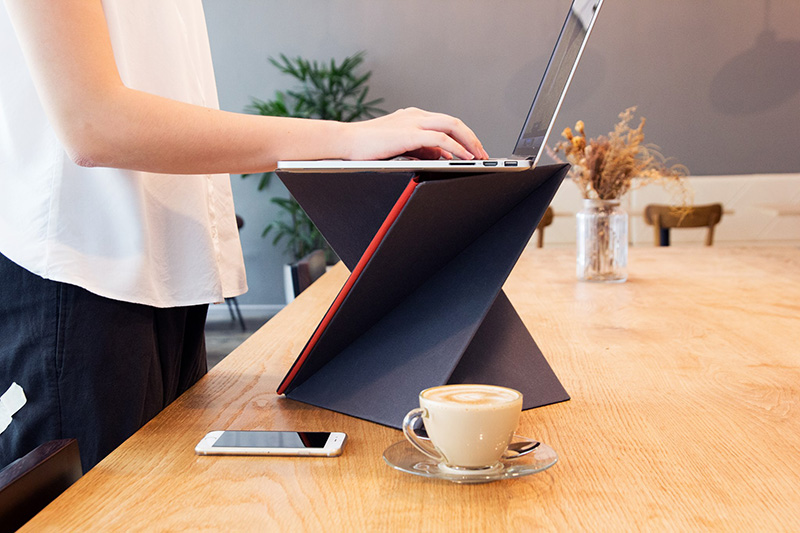 This Portable Standing Desk Folds Down To The Size Of A