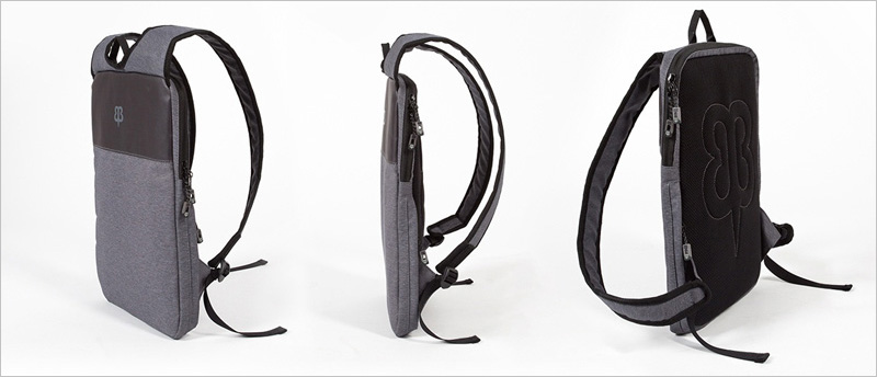 This thin laptop backpack is designed to be worn under a jacket ...