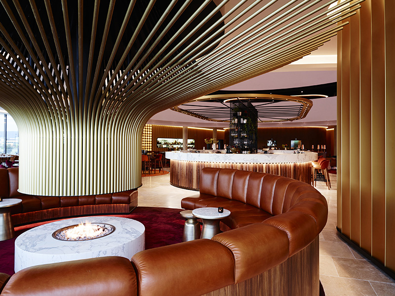 Design Detail - A Large Central Fireplace Stands Out In This Hotel Bar