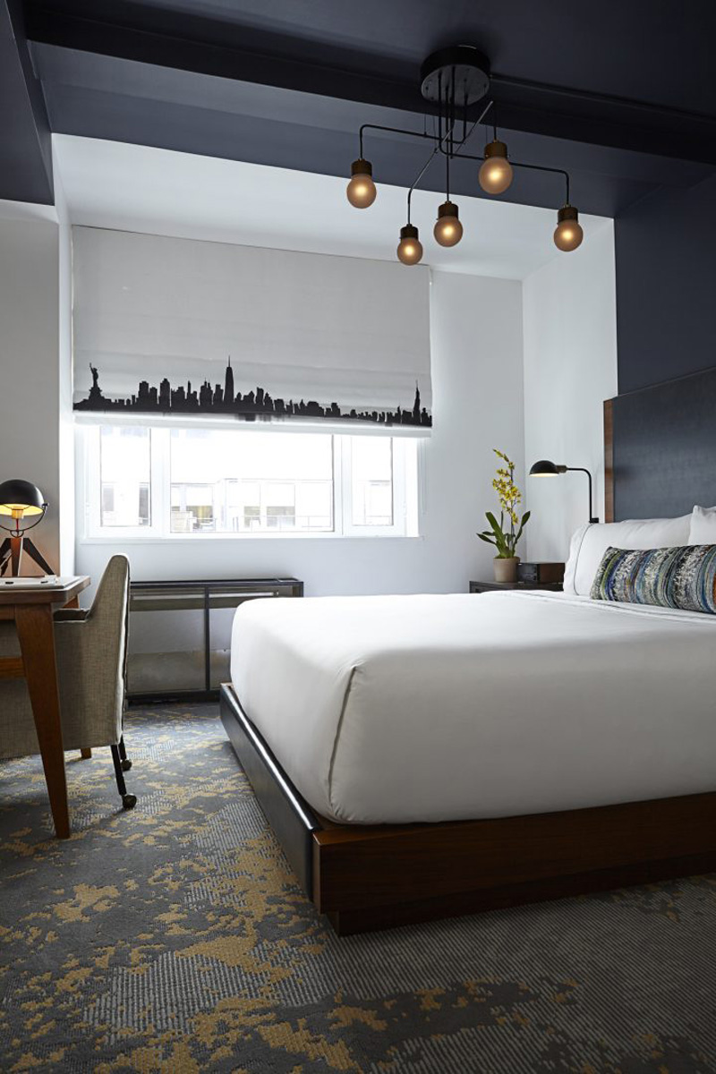 in this hotel suite are designed to define the space for the bed