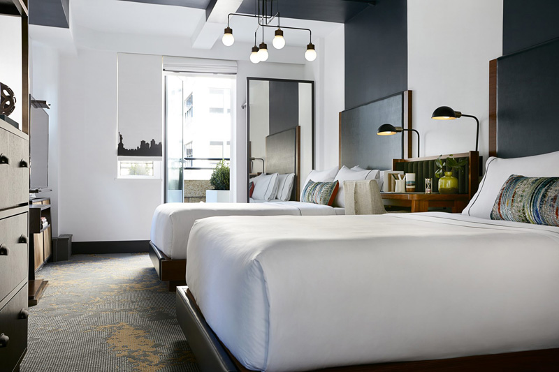 Design Detail - The headboards and paintwork in this hotel suite, are designed to define the space for the bed.
