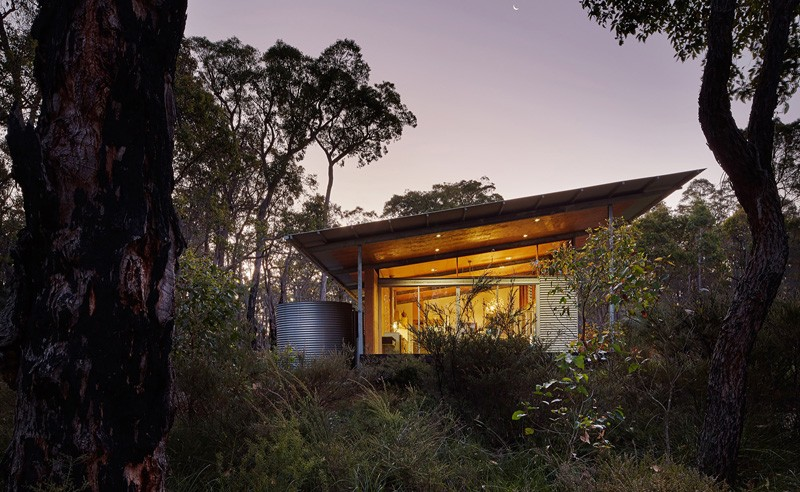 A Light Filled Home Clad In Corrugated Steel In The
