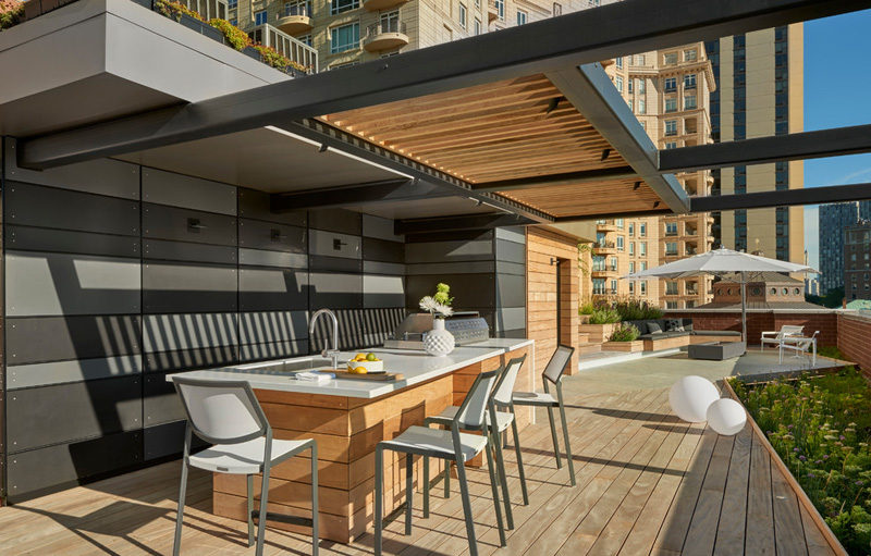 7 Design Lessons To Learn From This Awesome Roof Deck In Chicago // Define the uses of your deck -- With this design, they split the deck into different areas like food and dining, a seating area for gatherings, and a sun deck for lounging.
